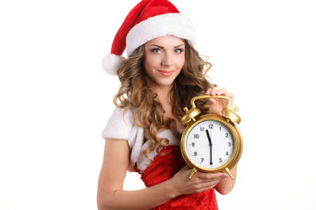 young happy smile woman wear santa clause costume, attractive christmas new year party girl looking at camera hold clock, isolated over white  photo