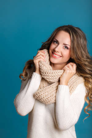 beautiful woman portrait wearing warm clothing  Studio portrait  photo