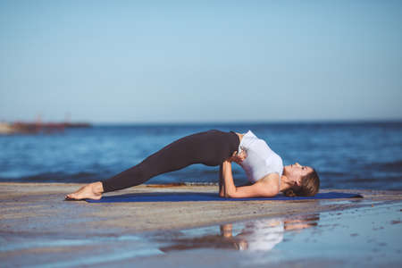 Healthy woman resting and curl up in fetal position outdoor at the sea  yoga pose  Series