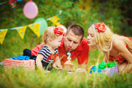 best party: Family celebrating birthday party in green park outdoors