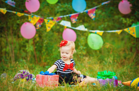 Happy little girl in the park on the nature of the summer outdoors Stock Photo - 26936015