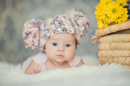 adorable smiling newborn baby girl lies in basket photo