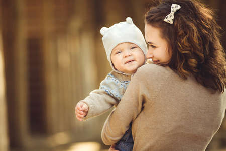 portrait of Young mother and her cute girl having fun i on a countryside n autumn photo