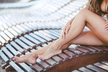 sexy legs: Women s sexy legs on the beach Stock Photo