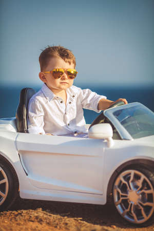 ridiculous: Funny boy car driver with the steering wheel Stock Photo