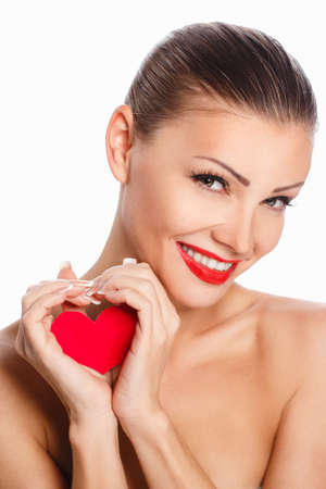 Portrait of Beautiful gorgeous smiling woman with glamour bright makeup and red heart in hand photo