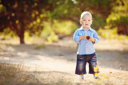 belonging to the caucasoid race: Little child outdoors in summer park Stock Photo