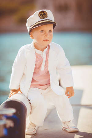 Little boy playing outdoor on the pier photo