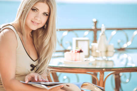 cote d'azure: vintage beautiful woman in restaurant cafe with tiramisu cake and coffee Healthy food drink for breakfast Stylish rich slim girl in retro dress glamorous lady at vacation  Retro style France series