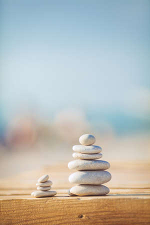 karesansui: zen stones jy wooden banch on the beach near sea  Outdoor