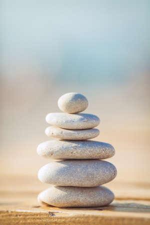 zen stones jy wooden banch on the beach near sea  Outdoor photo