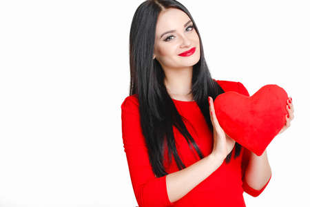 portrait of Beautiful gorgeous woman with glamourous bright makeup holding red heart isolated on white background  Manicured nails and Red Lips  photo