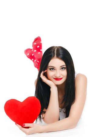 portrait of attractive happy smiling woman with red heart, love holiday valentine symbol over white background photo