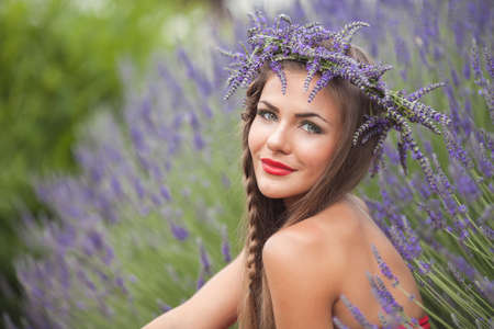 Beautiful provence woman relaxing in lavender field watching on sunset holding basket with lavanda flowers  Series  alluring girl with purple lavender  blond lady in blossom field   Ukraine - Crimea photo