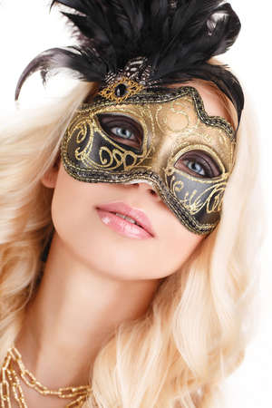 near the portrait of a beautiful blonde with Venetian mask on white background photo