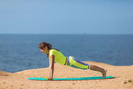 Woman yoga  Series  Outdoor  On the seashore photo