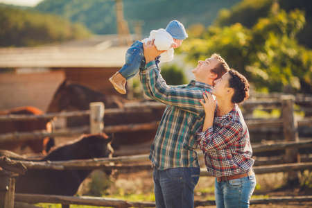 Young happy family having fun at countryside photo