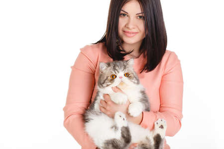 similarity: elegant woman wearing grey felt hat in retro style holding cat  Glance of woman and cat is the same  Resembling, similarity
