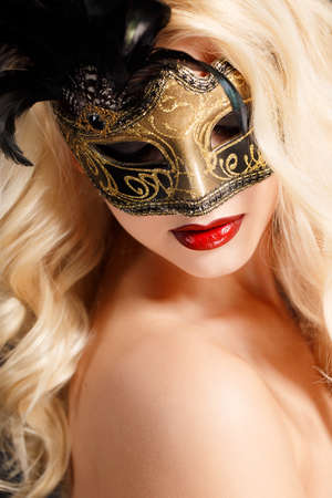 Close up portrait of woman in venetian mask  Carnival mask Close-up female portrait Blue eyes  Dark  photo