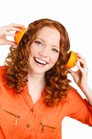 portrait of Beautiful close-up young red hair woman with oranges photo