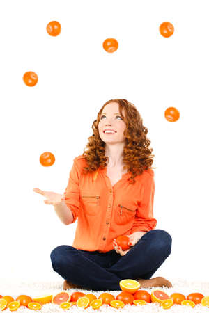 portrait of attractive caucasian smiling woman isolated on white studio shot with oranges photo
