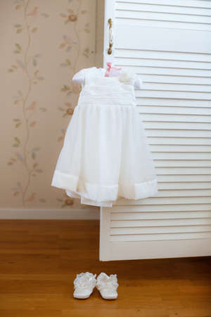 fashion  babies's wear: Children s white elegant dress hanging on hanger  Stock Photo