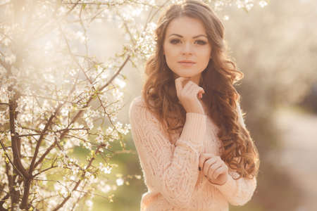 Beautiful woman enjoying outdoors, nice female  pretty girl relaxing outdoor, having fun, happy young lady and spring green nature and blooming trees, harmony concept photo
