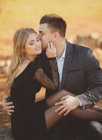 kisser: Portrait of a young couple in autumn Park Stock Photo