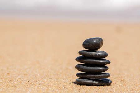karesansui: Zen stones jy on the sandy beach near the sea  Outdoor