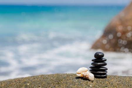Zen stones jy on the sandy beach near the sea  Outdoor  photo