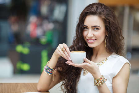 Woman drinking coffee at home photo
