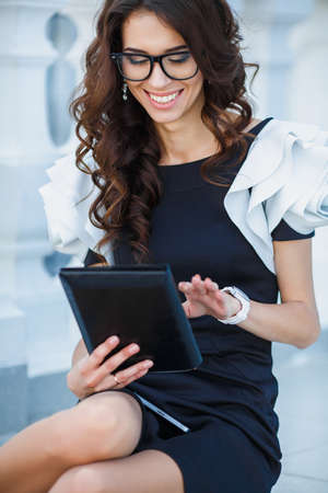 achiever: Successful woman holding digital tablet  Businesswoman using internet device and smiling  Professional success concept