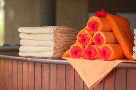Pile of towels near the swimming pool at a tropical resort photo