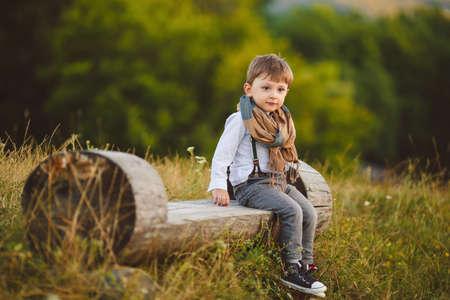jungle boy: stylish baby boy having fun outside in the park  Cute happy boy child outdoors