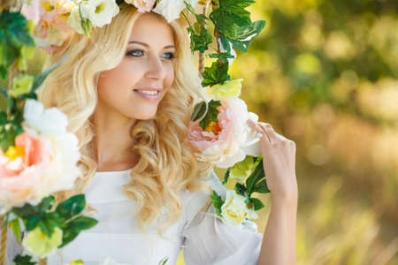 Portrait of beautiful young girl outdoors in spring