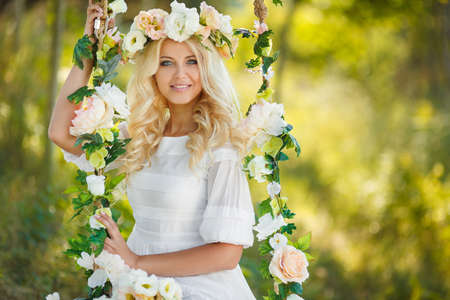 Portrait of beautiful young girl outdoors in spring photo