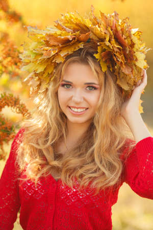 Autumn Woman Portrait  Beauty Fashion Model Girl with Autumnal Make up and Hair style  Fall  Creative Autumn Makeup  Beautiful Face  photo