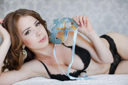unwinding: Beautiful sexy woman in bed