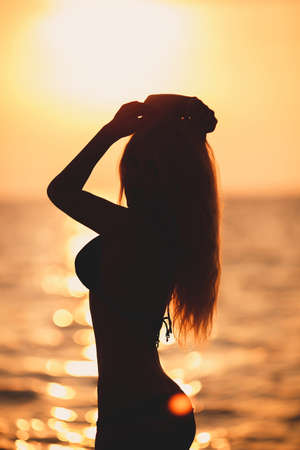Portrait of attractive blond woman at the sunset photo