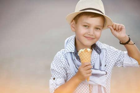 kid eating ice cream ioutdoor. happy child boy eating ice cream Stock Photo - 31022932