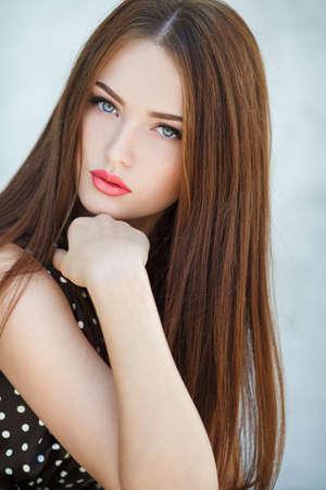 Woman with beauty long brown hair - posing at studio photo