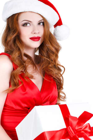 Beautiful young girl in a Christmas costume and gift in hand on a white background. photo
