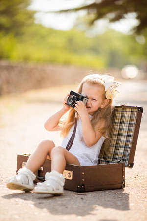 Quite the little photographer girl in a white dress with a white bow on her head,white socks and white sandals,old dad\\\\\\\\ photo