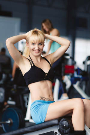 intervals: Woman working out in fitness - Active girl. beautiful athletic woman working ab intervals