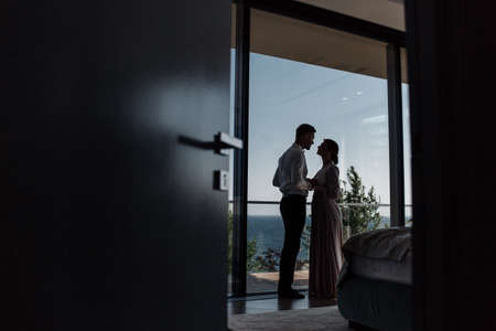 Loving couple at the hotel on a honeymoon. Just married. Honeymoon concept. Romantic relations. True love. Family love. Couple in love. Cute relationship. Man and woman cuddle nature background. Together forever. Love story of the newlyweds. Banco de Imagens