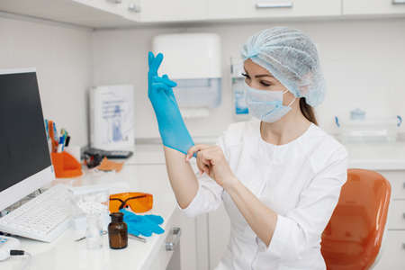Medical doctor working in research lab. Science assistant making experiments. Laboratory tools: microscope, test tubes, equipment. Chemistry, medicine, biochemistry and healthcare. Scientific in lab analysis of new corona virus. Covid-19 concept.