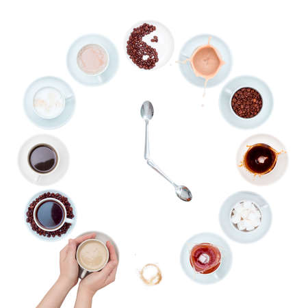 It's time to drink coffee. White cups and saucers with tea, sugar and coffee in the form of a clock face with spoons in the form of hour hands. White background, top view.