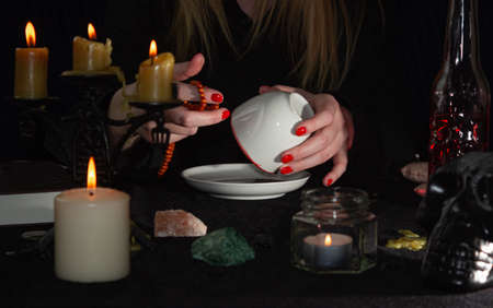 Evil spells and witchcraft. Magic to cause harm to humans. Deadly conspiracy and ritual. Occultism and magic. Ceremonies on the photo. Dangerous sorcerers charlatans.