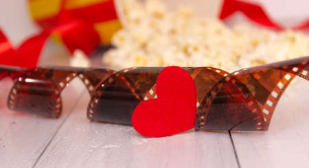 Red heart and film. The concept of cinema, love.