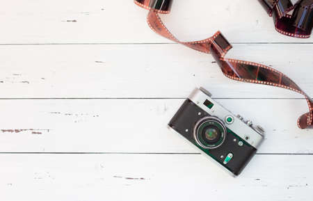 A rare camera and film on a white background. Free space for text.